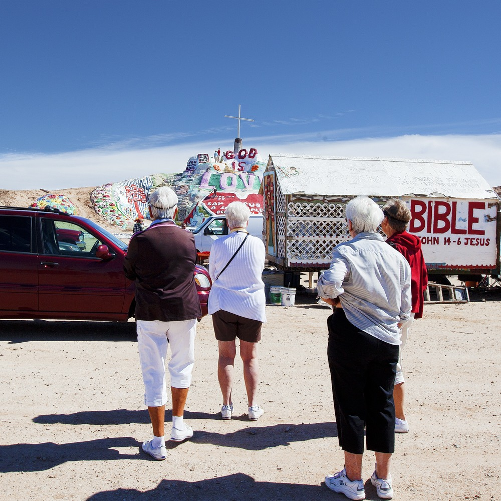 Tourists,Salvation Mountain, CA.